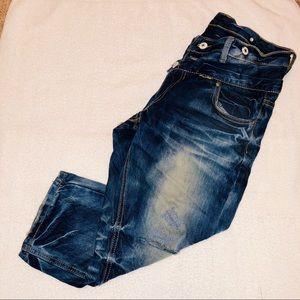 Denim - Distressed wrinkled capri jeans